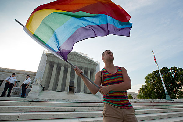 A gay rights advocate celebrating the repeal of DOMA in front of the Supreme Court in June 2013.