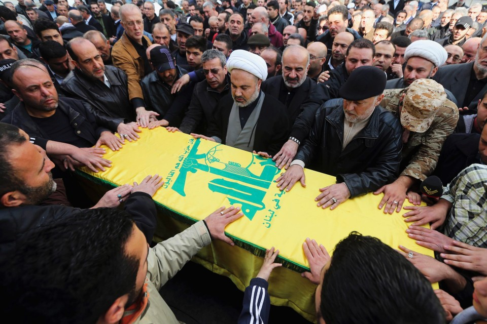 Hizbollah supporters in Lebanon along the procession of Adnan Awale,  who was killed by a car bomb January 4, 2014 in a Shia suburb of Beirut. Photo by Reuters/Hasan Shaaban.