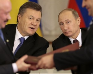 Ukranian President Viktor Yanukovych with Russian President Vladmir Putin. The protests are now focused on the resignation of President Yanukovych and a call for new elections. Photo on the AP.