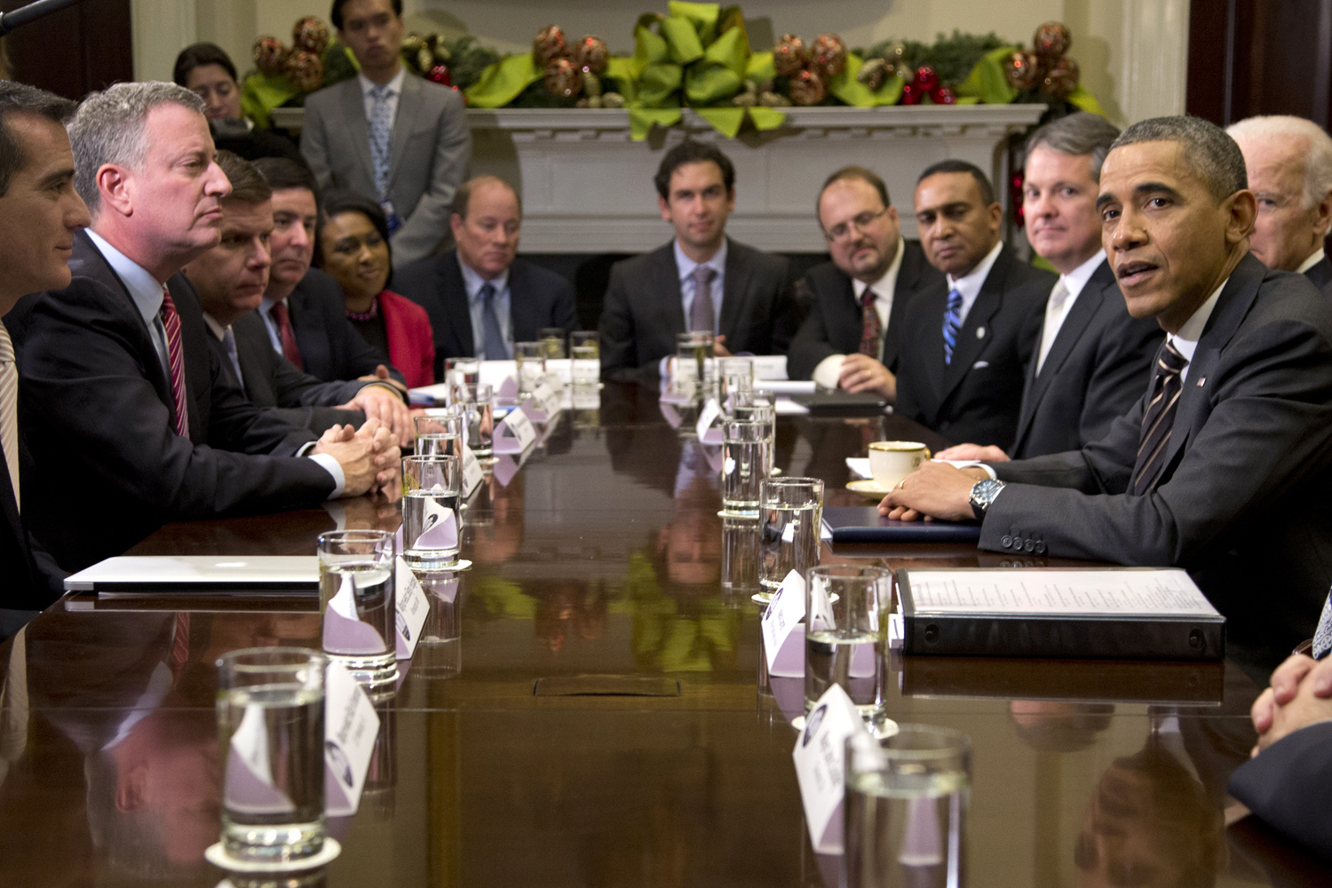 President Obama at a December 2013 meeting with US municipal mayors, including Bill De Blasio, discussing income equality. Photo by AP Photo/Carolyn Kaster.