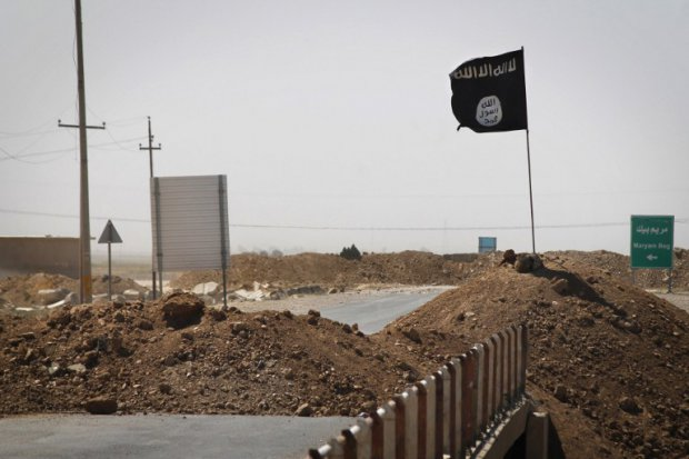 The Islamic State flag flies over Iraq. Photo by JM Lopez/AFP.