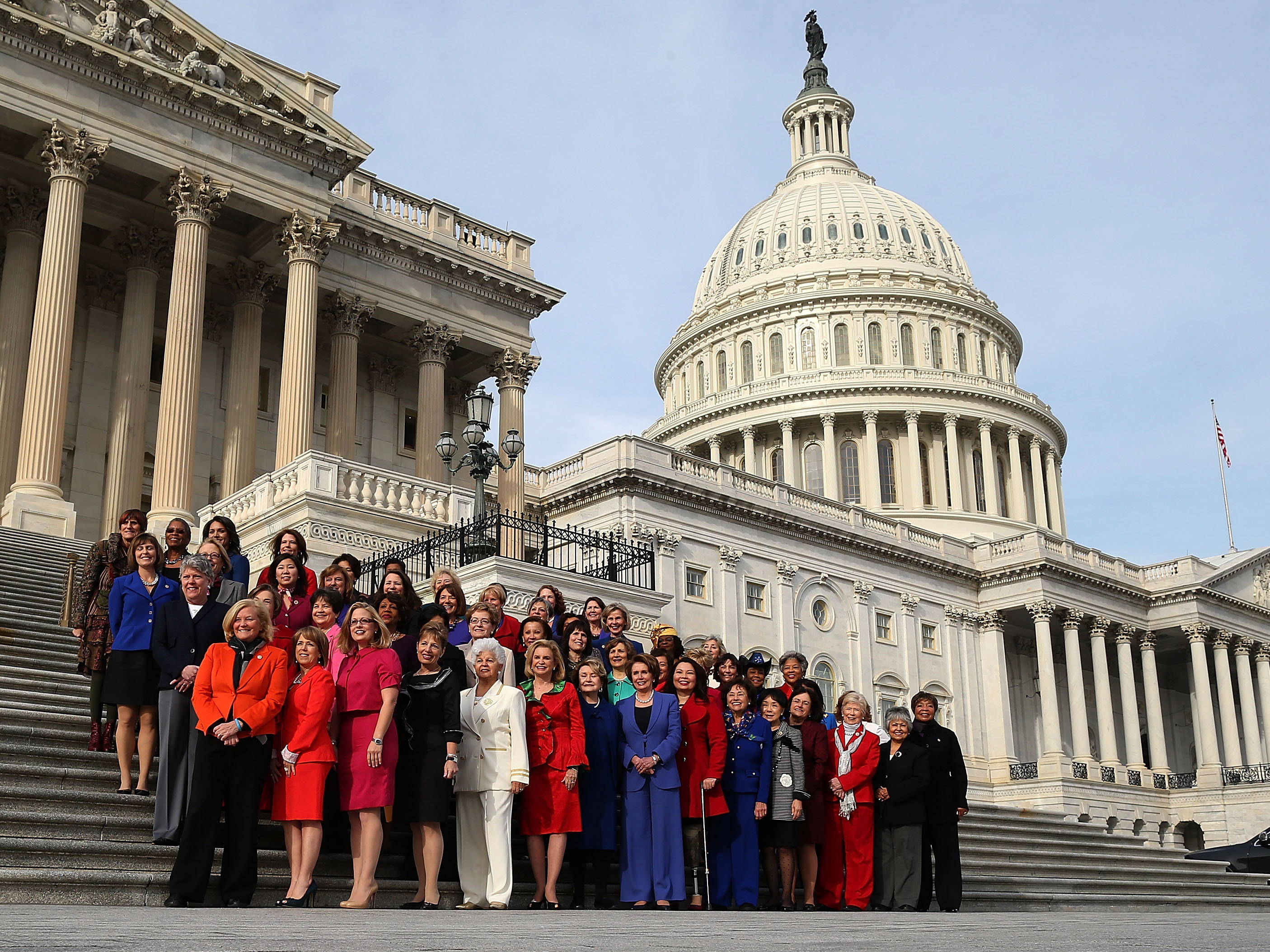 WASHINGTON, DC - JANUARY 03: Democratic Leader Nancy Pelosi (D-CA) (C), stands with the Democratic women of the House to highlight the historic diversity of the House Democratic Caucus, on January 3, 2013 in Washington, DC. The new 113th Congress will be sworn in today.  (Photo by Mark Wilson/Getty Images)