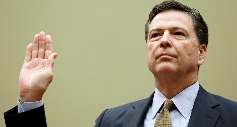 """Director James Comey is sworn in before testifying at a House Oversight and Government Reform Committee on the """"Oversight of the State Department"""" in Washington U.S. July 7, 2016. REUTERS/Gary Cameron"""