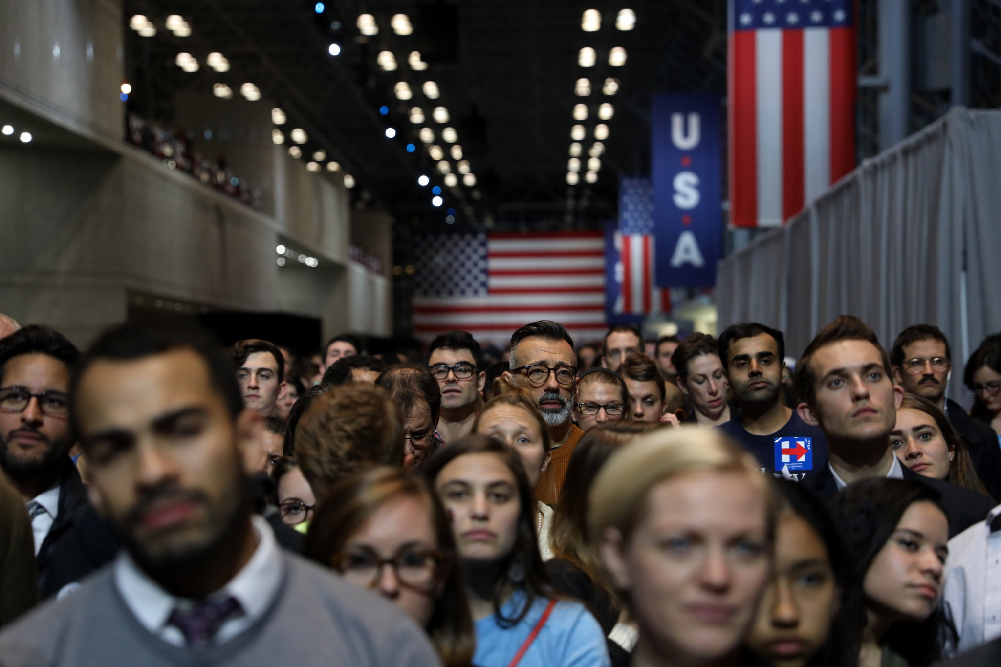 Hillary Clinton supporters at the Jacob K. Javits Convention Center in Manhattan watched as election returns were announced on Tuesday.  (Todd Heisler/The New York Times)